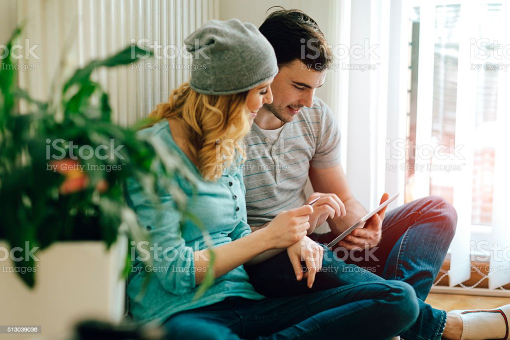 Happy Couple Shopping Online. stock photo