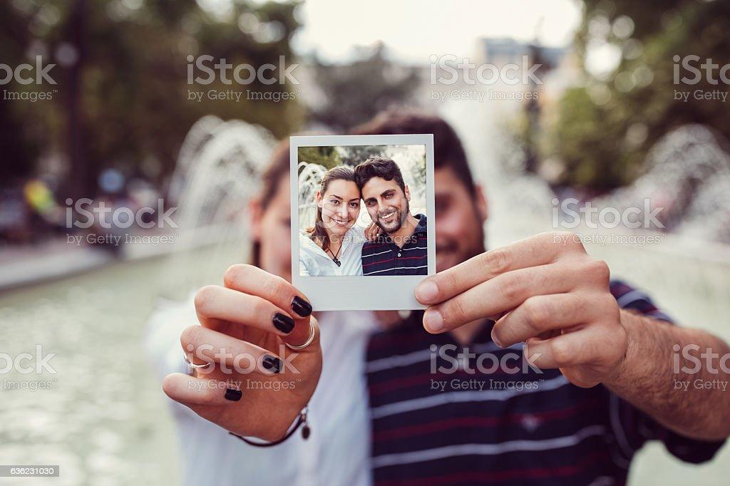 Happy couple showing instant selfie stock photo