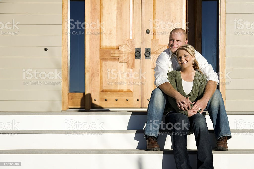 Happy Couple Sitting on Front Step royalty-free stock photo