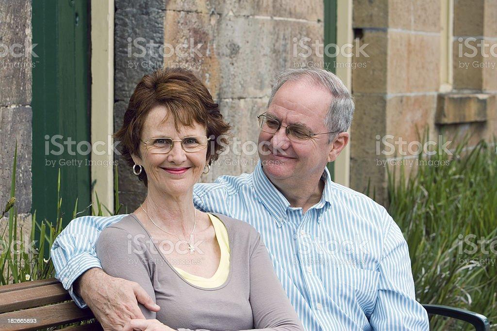 Happy couple sitting. royalty-free stock photo