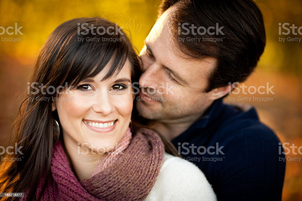 Happy Couple Sitting Together in the Woods During Autumn royalty-free stock photo