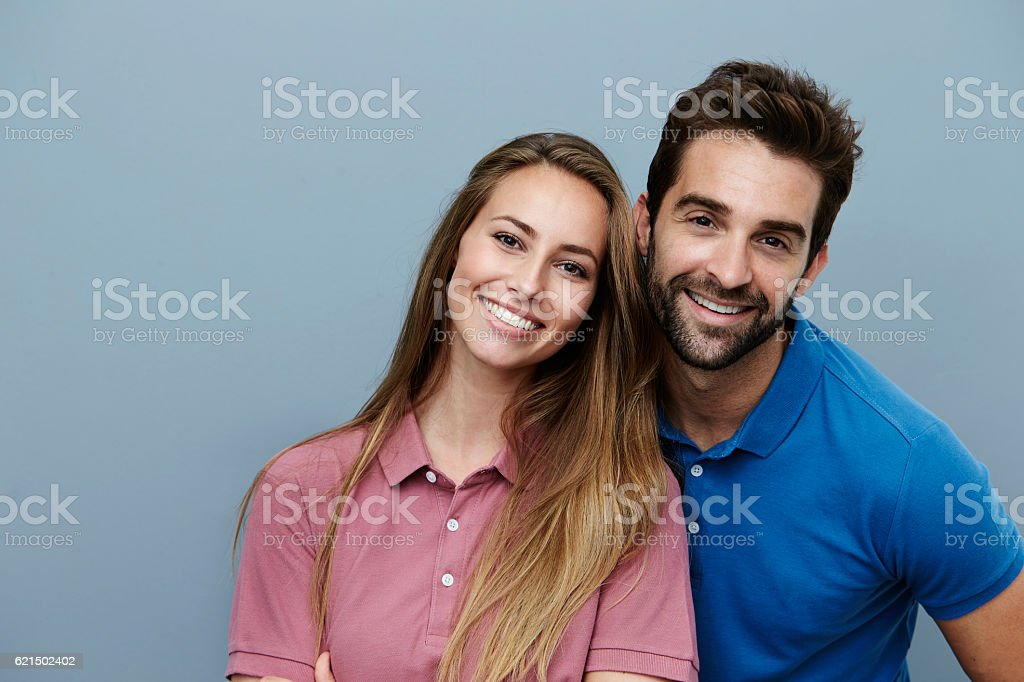 Happy couple smiling in polo shirts, portrait stock photo
