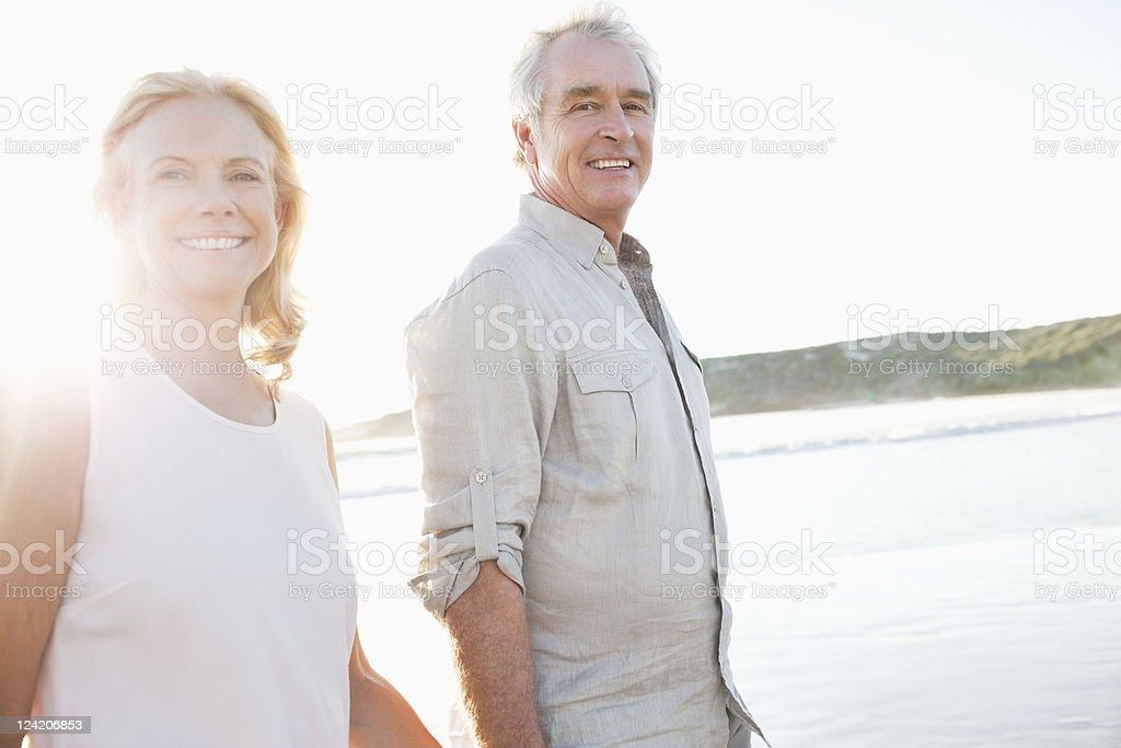 Happy couple smiling on beach stock photo