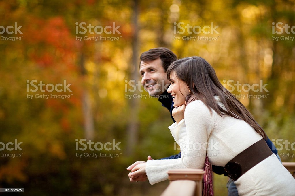 Happy Couple Smiling Together in the Woods Outside During Autumn royalty-free stock photo