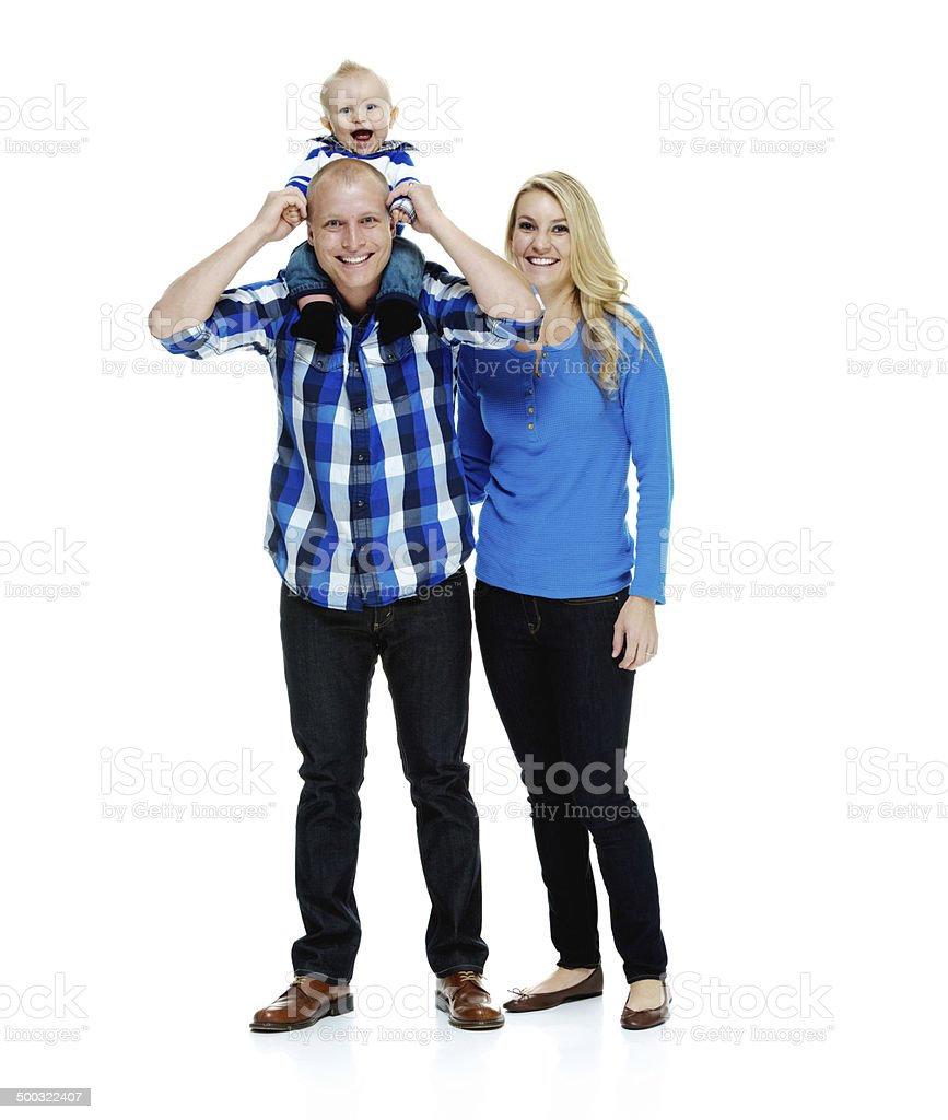Happy couple standing with their baby royalty-free stock photo