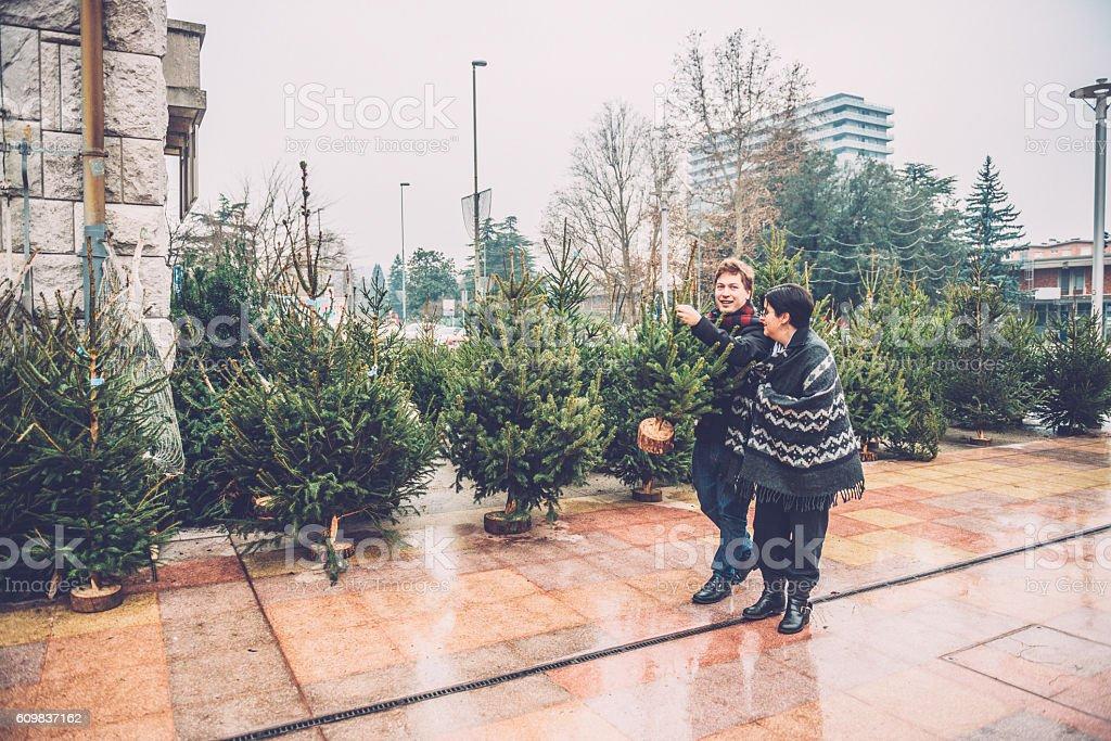 Happy Couple Taking Christmas Tree Home, City Market, Europe stock photo