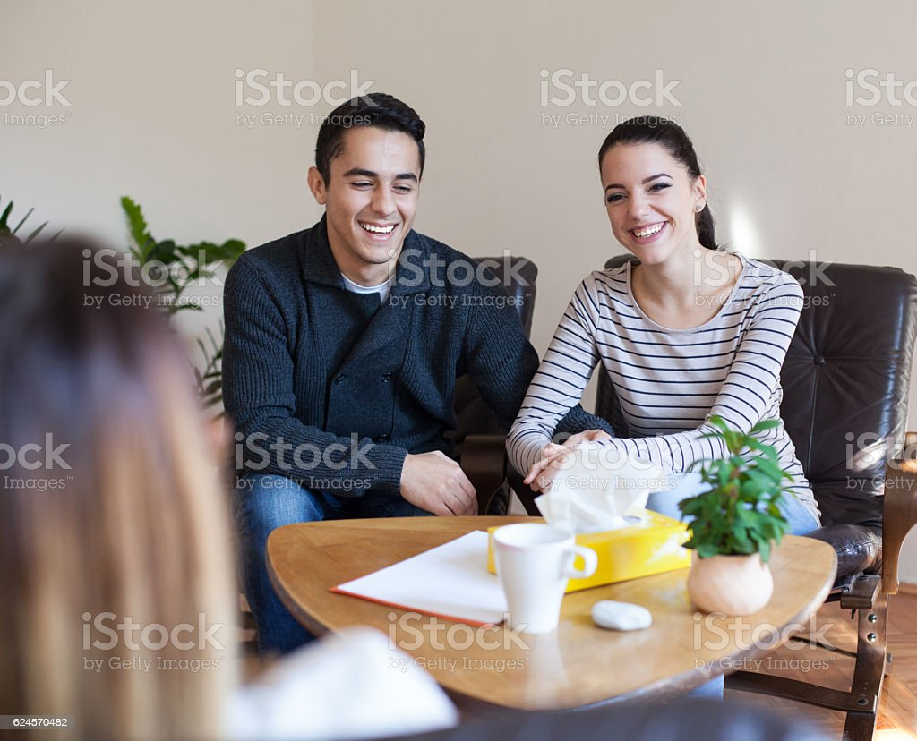 Happy Couple Talking to Counselor stock photo