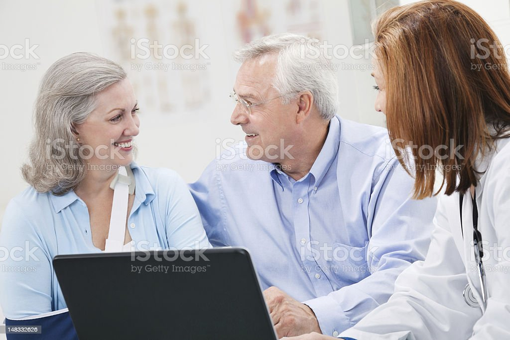 Happy Couple Talking Together at Doctor's Office royalty-free stock photo