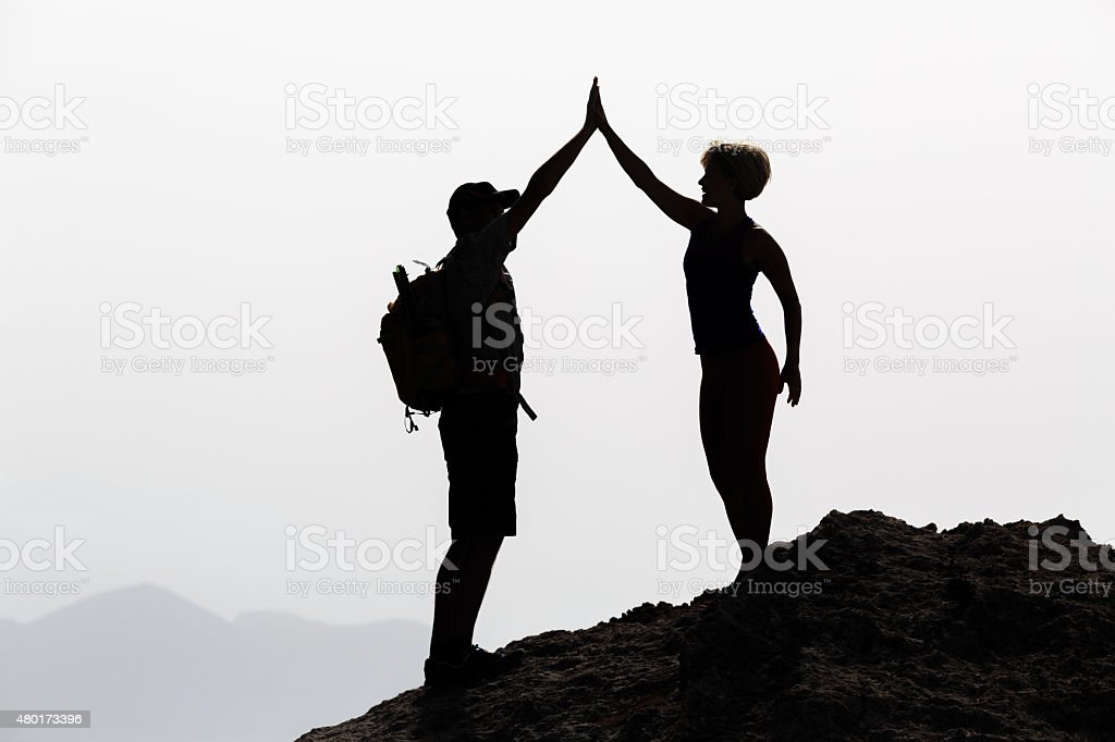 Happy couple teamwork celebrate reaching life goal and success stock photo