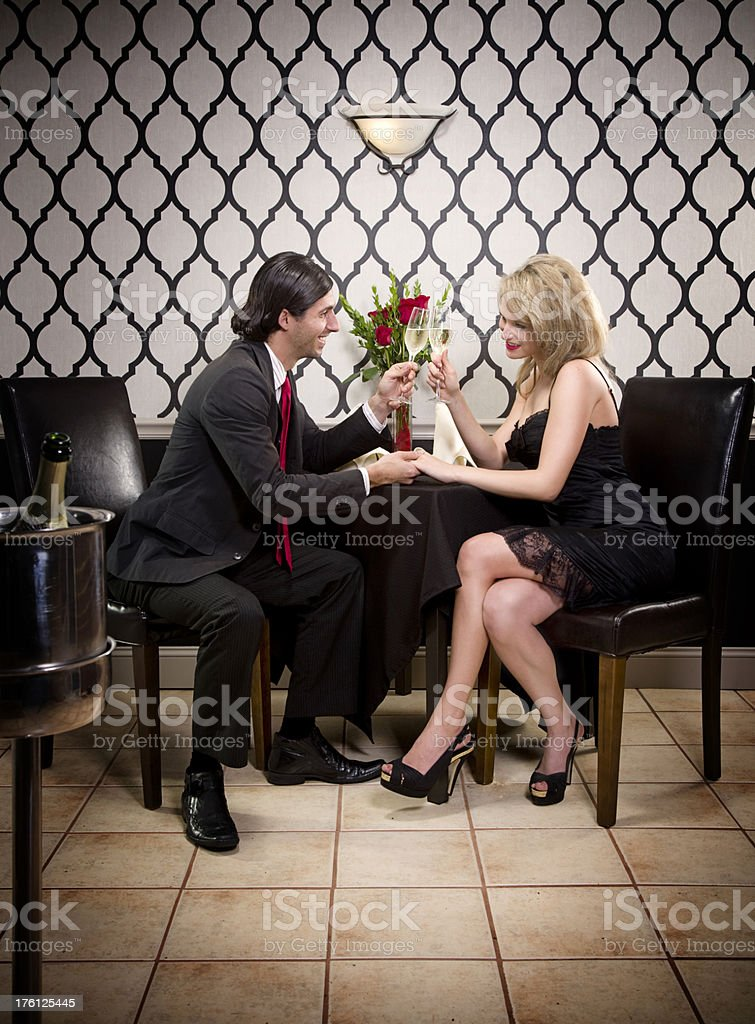 Happy Couple Toasting a Celebration in a Restaurant royalty-free stock photo
