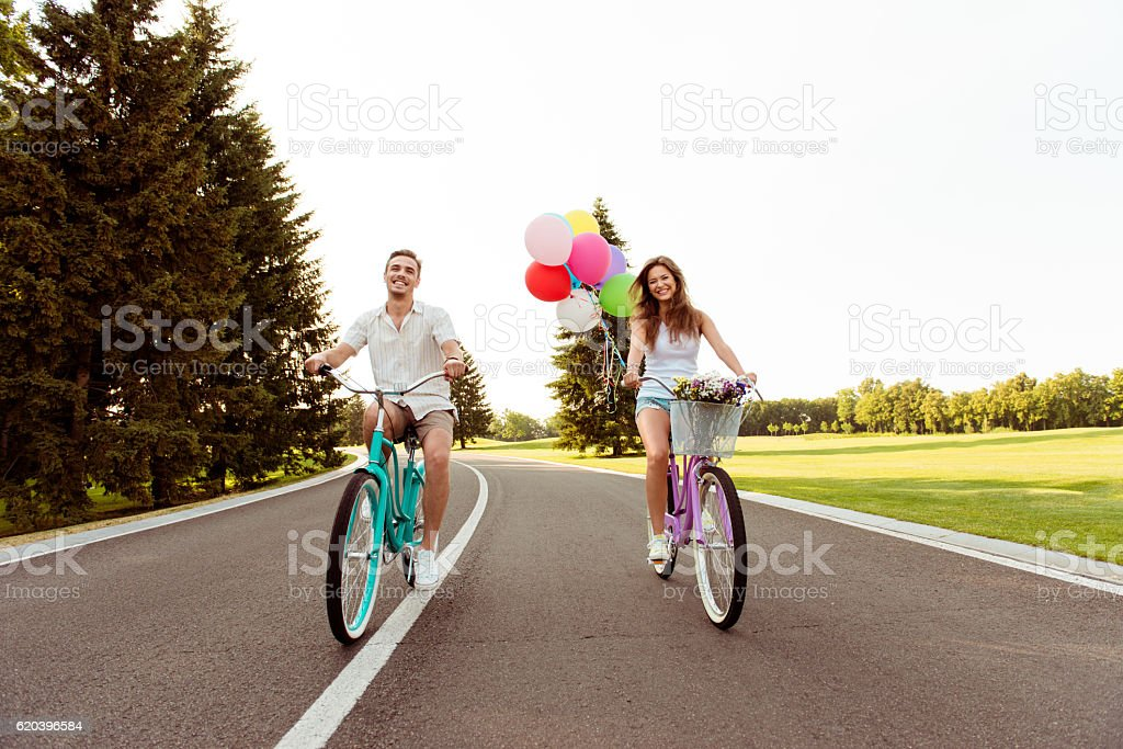 happy couple together to ride a bicycle stock photo