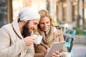 Happy couple using digital tablet.