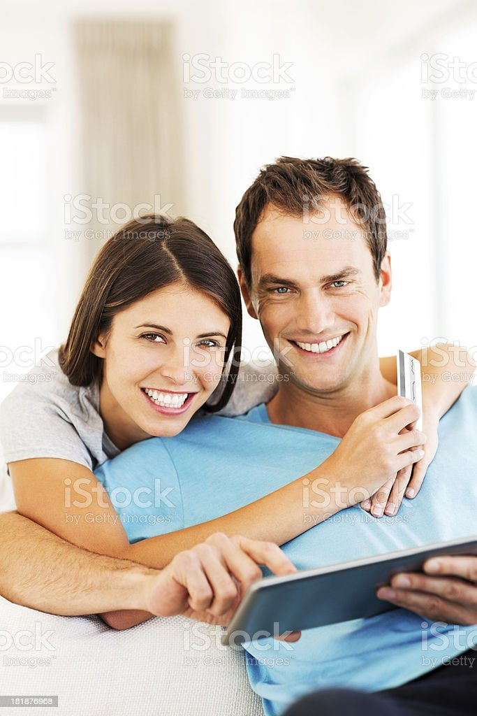 Happy Couple Using Tablet Computer And Credit Card royalty-free stock photo