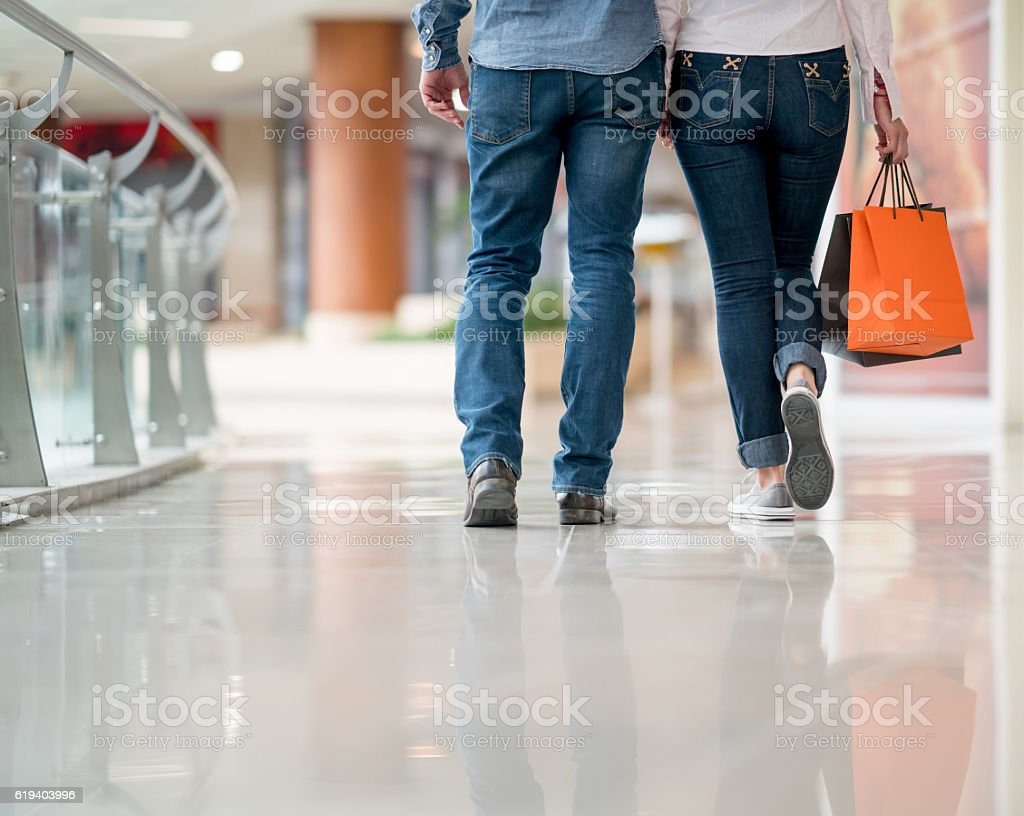 Happy couple walking at the shopping center stock photo
