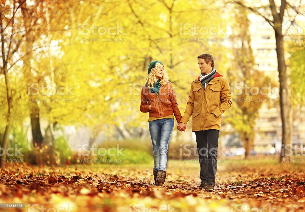 Happy couple walking in park. royalty-free stock photo