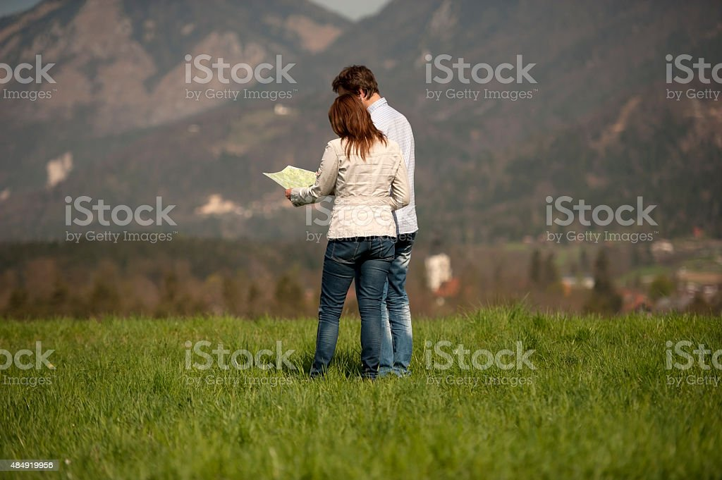 Happy couple walking on the grass stock photo