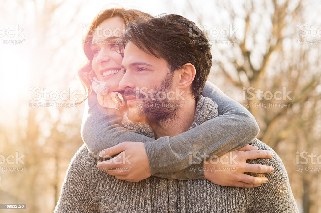 A happy couple walking through a field  stock photo