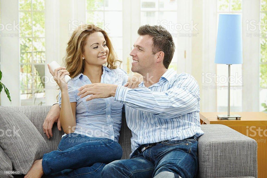 Happy couple watching TV stock photo
