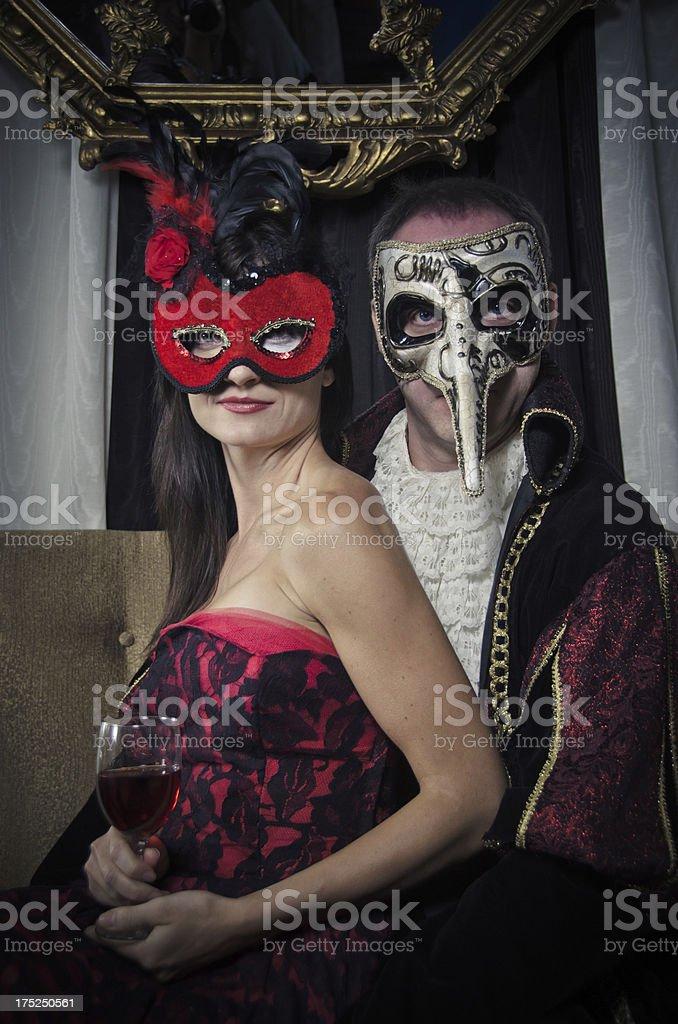 Happy Couple Wearing a Venetian Masks royalty-free stock photo