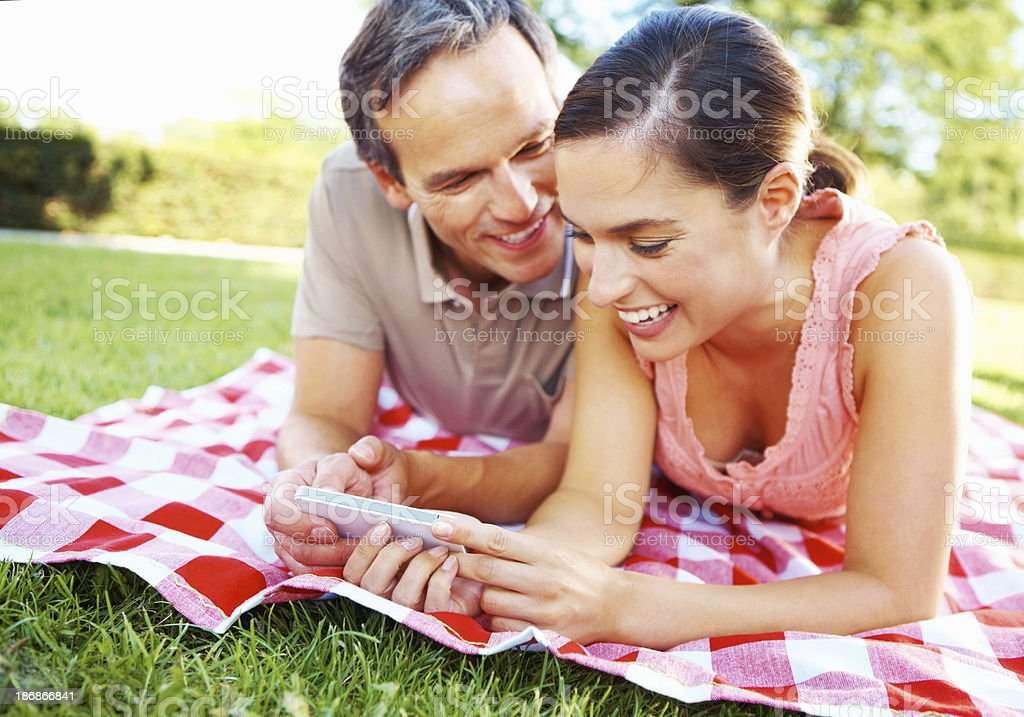 Happy couple with a cellphone royalty-free stock photo