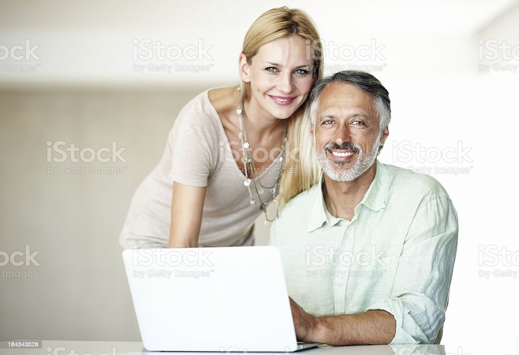 Happy couple with a laptop royalty-free stock photo