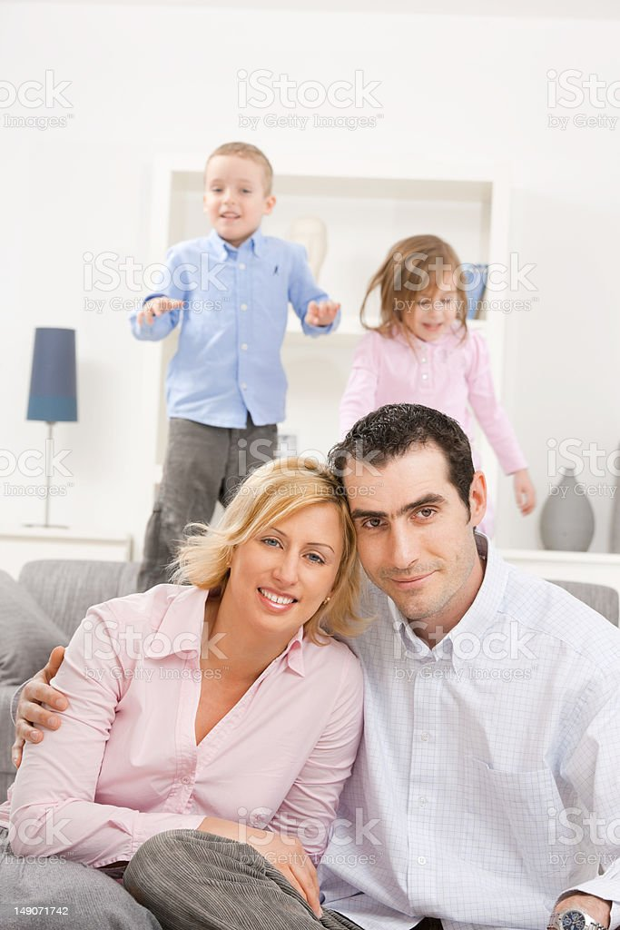 Happy couple with children royalty-free stock photo