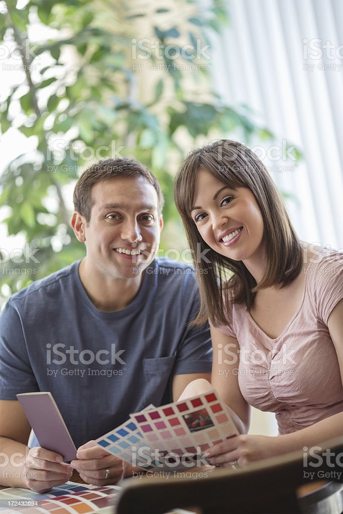 Happy Couple With Color Catalog At Home stock photo
