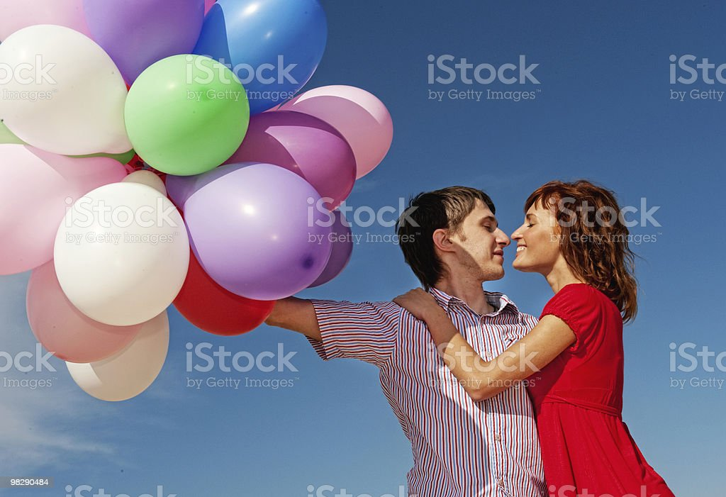 Happy couple with colorful balloons outdoors royalty-free stock photo