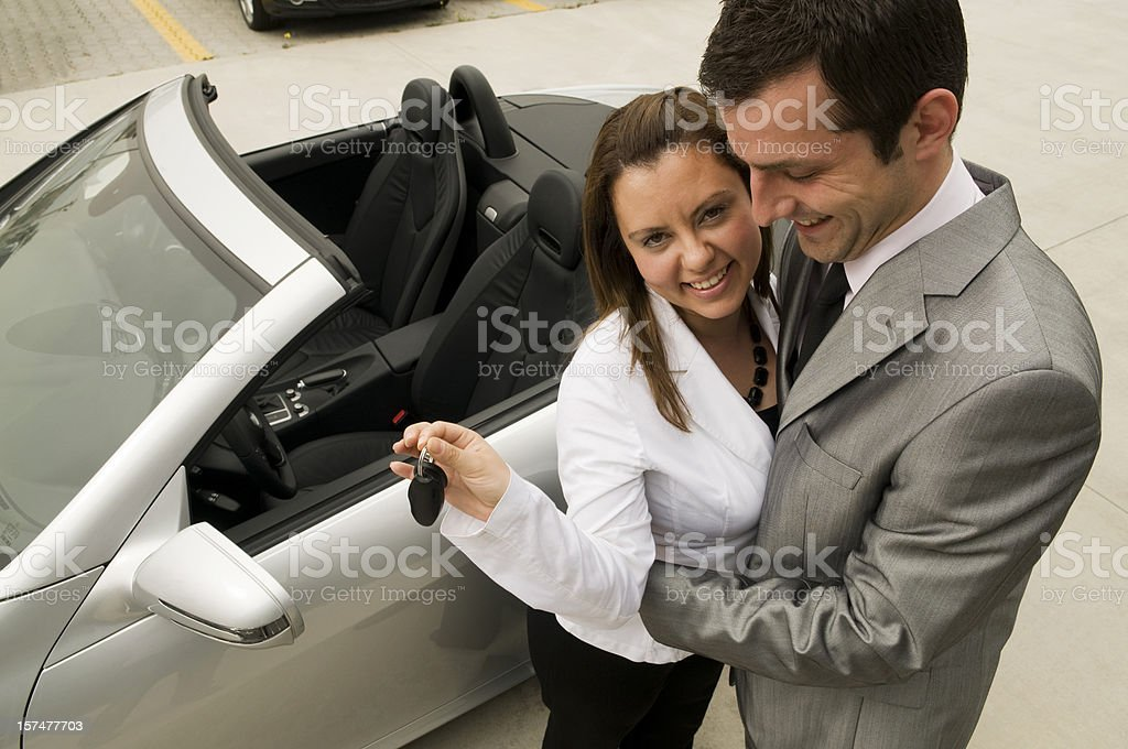 Happy couple with convertible royalty-free stock photo
