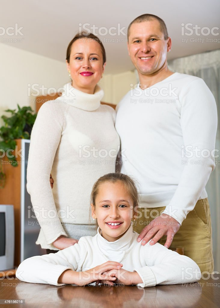 Happy couple with daughter at home stock photo