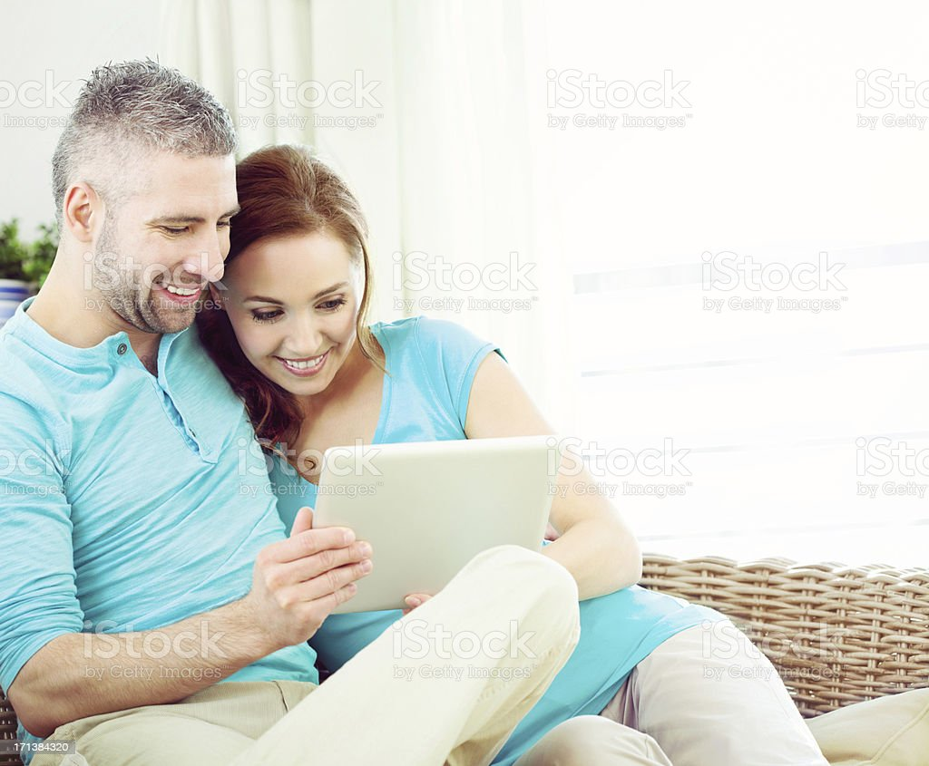 Happy Couple with digital tablet royalty-free stock photo