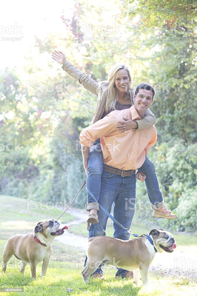 happy couple with dogs royalty-free stock photo