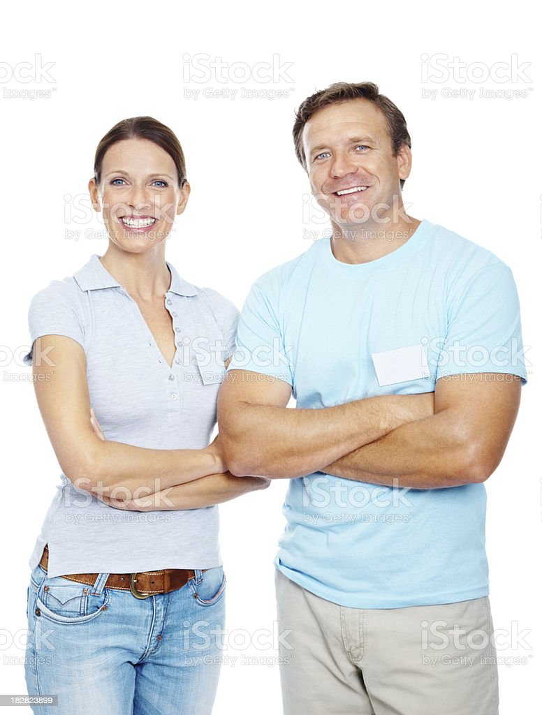 Happy couple with hands crossed against white background stock photo