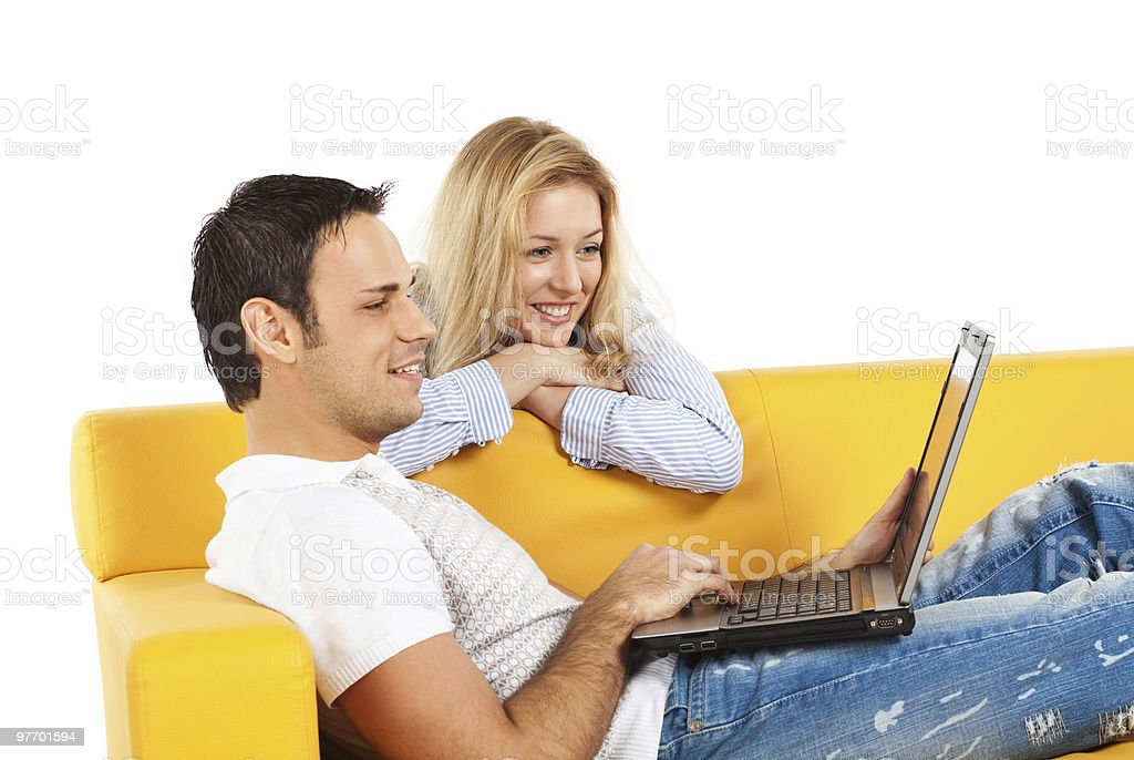 Happy couple with laptop computer royalty-free stock photo