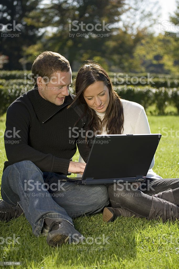 Happy couple with laptop royalty-free stock photo