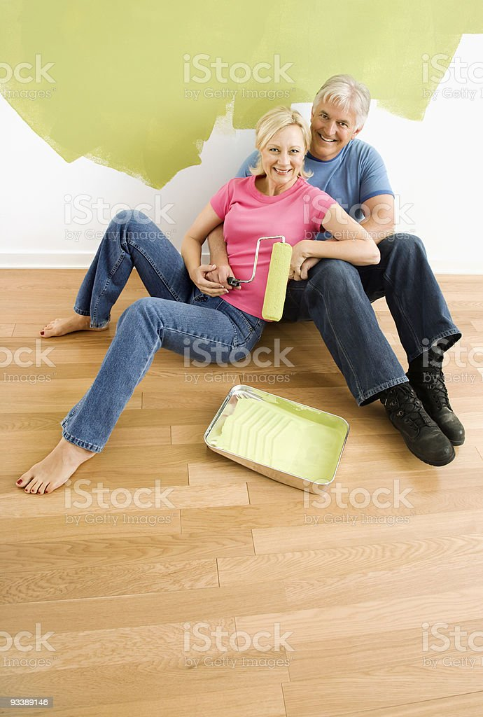 Happy couple with painting utensils. royalty-free stock photo