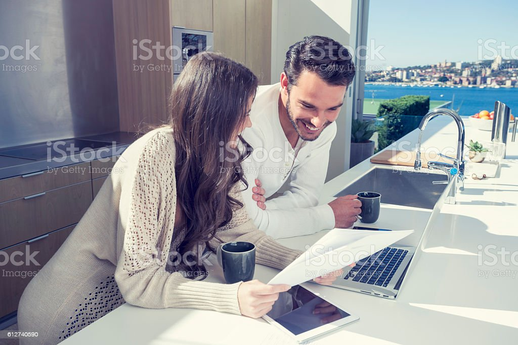 Happy couple with paperwork. stock photo
