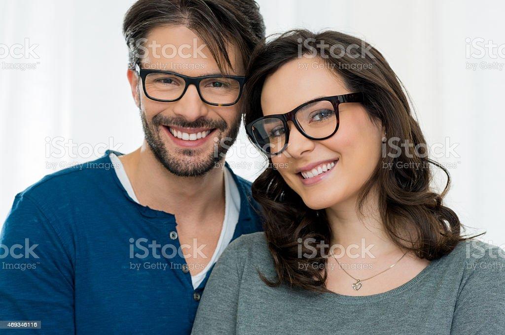 Happy couple with specs stock photo