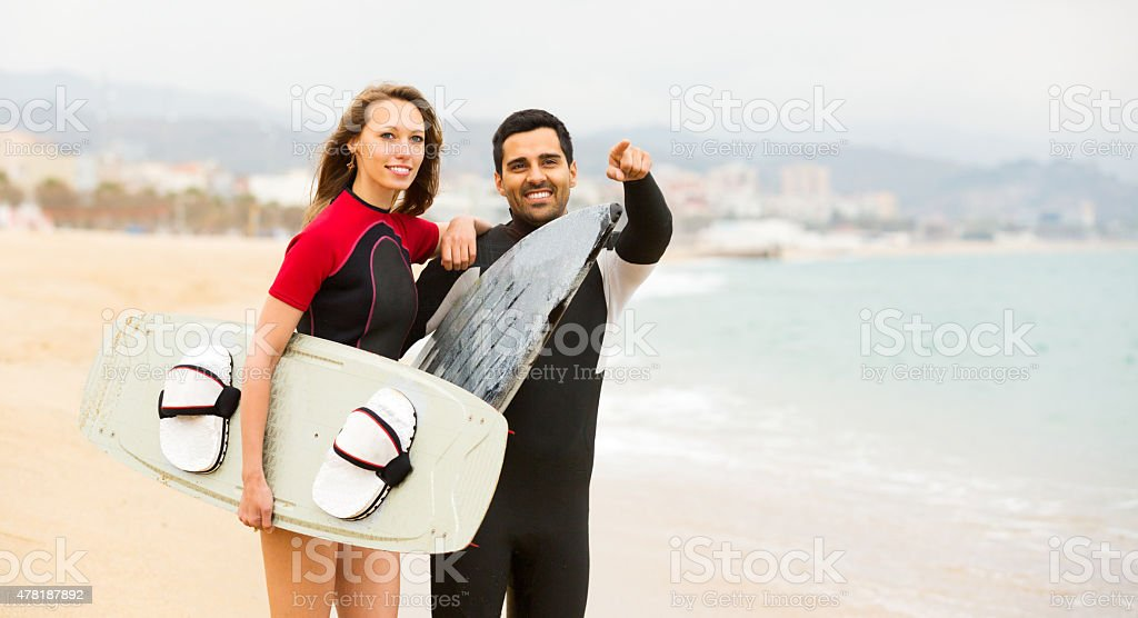 Happy couple with surf boards stock photo