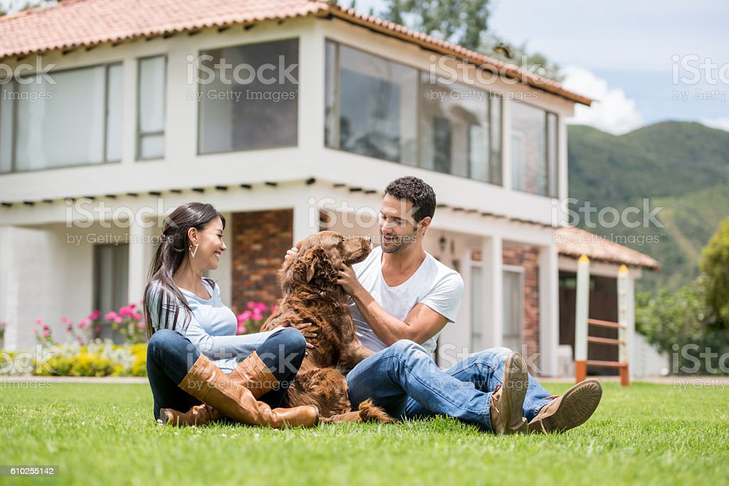 Happy couple with their dog stock photo
