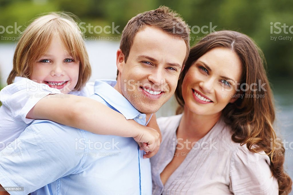 Happy couple with their son enjoying vacation royalty-free stock photo
