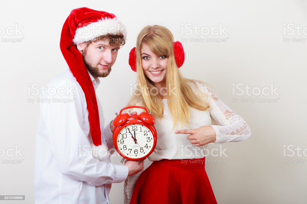 Happy couple woman and man with alarm clock. stock photo