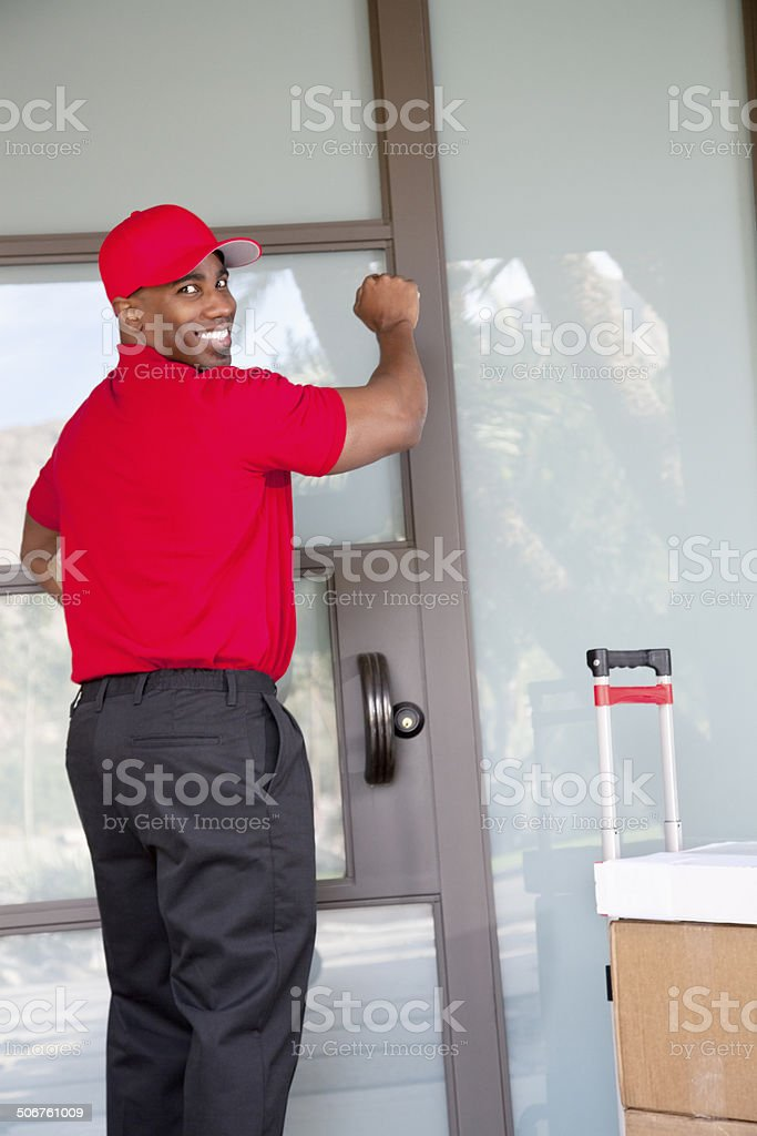Happy Courier working stock photo
