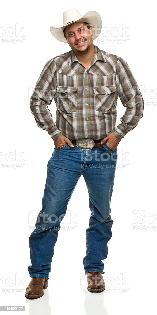 Happy Cowboy With Hands in Pockets stock photo