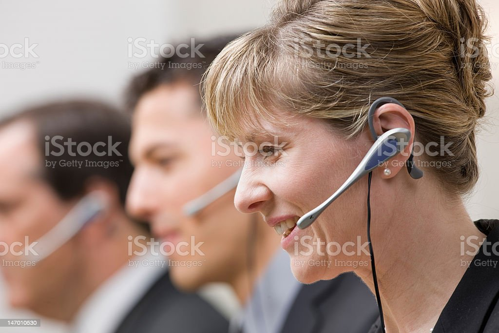 Happy co-workers in call center royalty-free stock photo