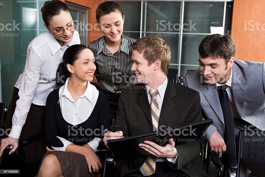 Happy coworkers looking at paperwork royalty-free stock photo