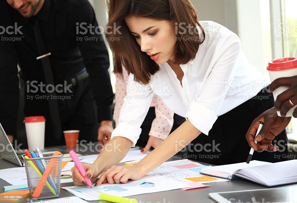 Happy creative business people in meeting stock photo