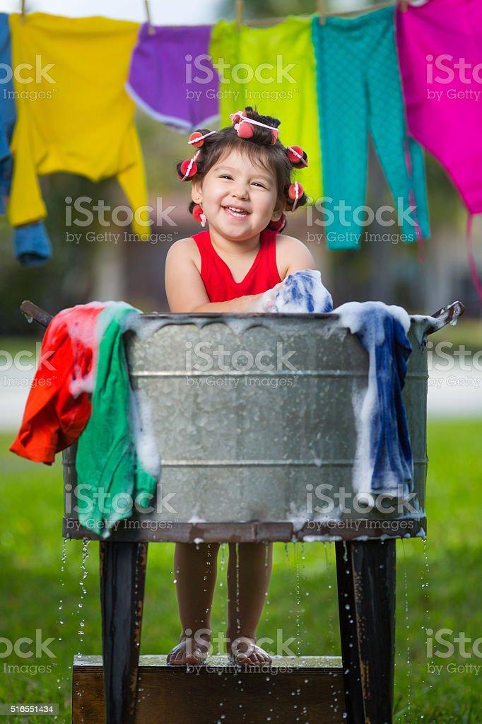 Happy cuban girl washing stock photo
