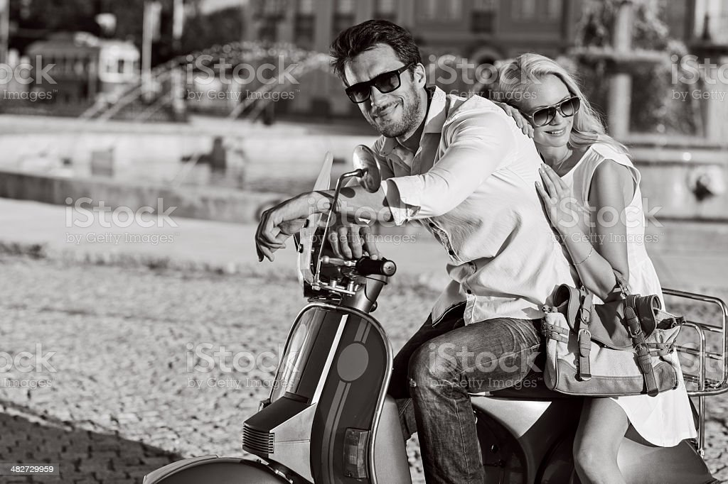 Happy cuople on scooter stock photo