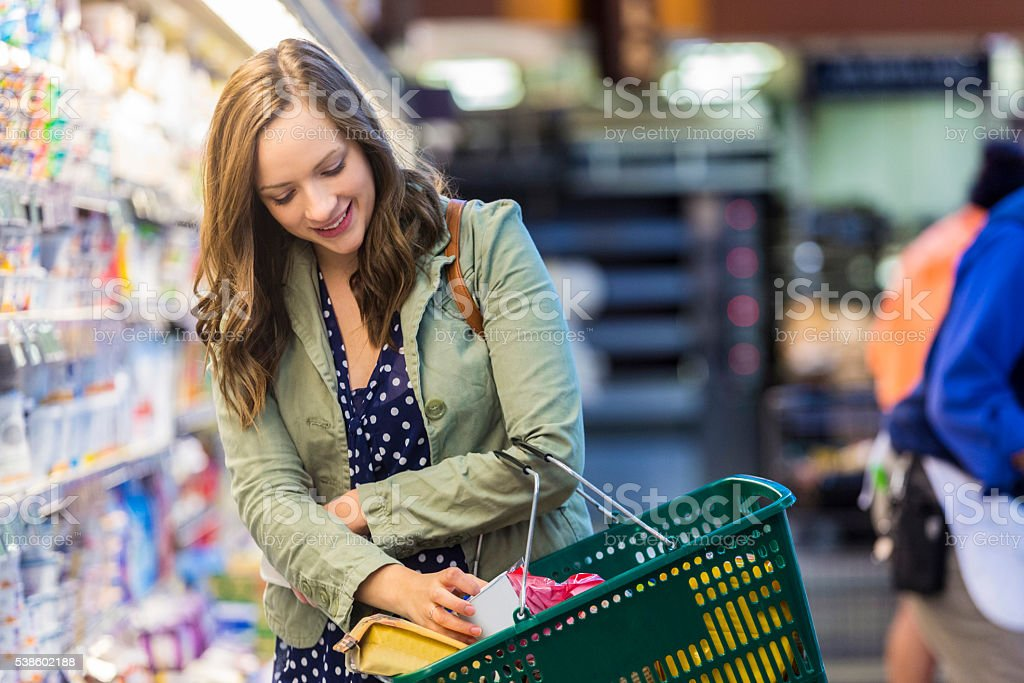 Happy customer at grocery store stock photo